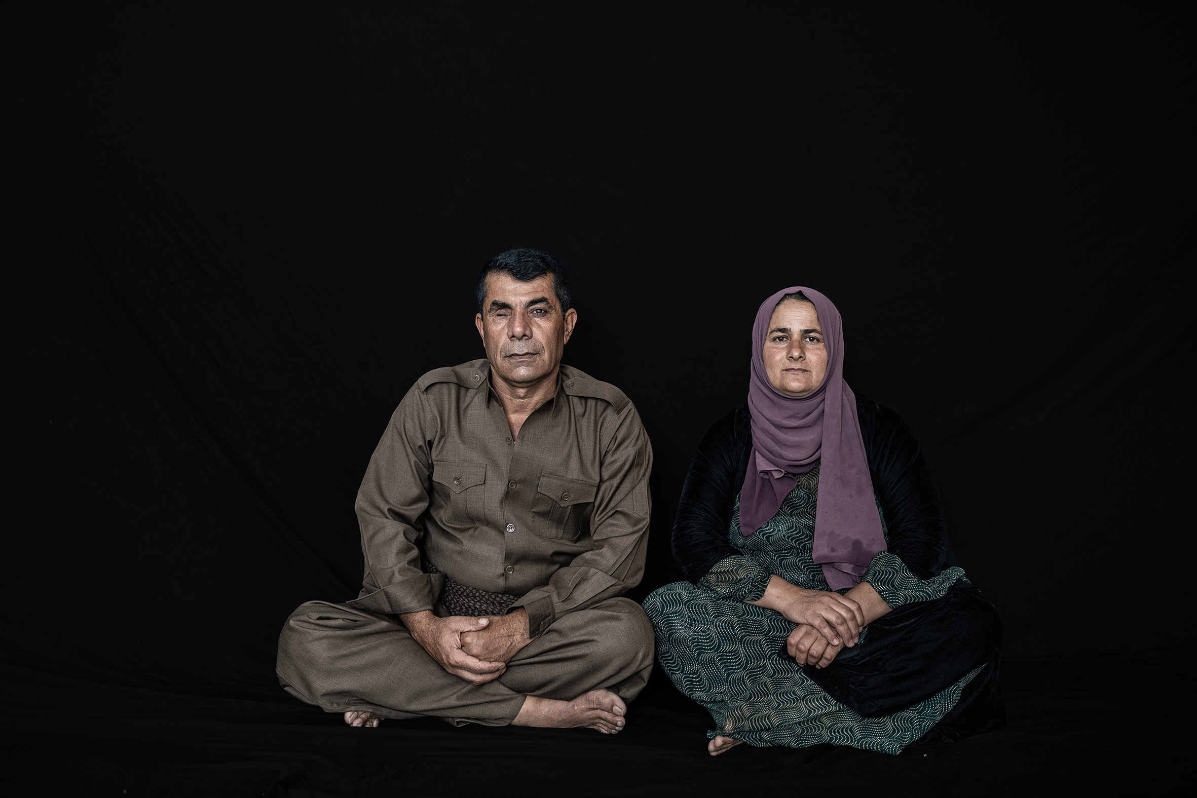 Mohammad Sharif Shakhsa Abdullah was born in 1972 and his wife Bas Hama Kheder was born in 1976, he is Peshmarga since 1991 and he got wounded in fighting ISIS in Jul 2014 with a Grenade or RPG in Jalawla in Diyala province.He lost one eye and he got hundreds of shrapnel in his face and body. After 29 days after his wounding, he goes back to the frontline and continues fighting IS, He has Six kids. According to Media reporters, more than 10,000 Peshmargah were wounded in the IS war.